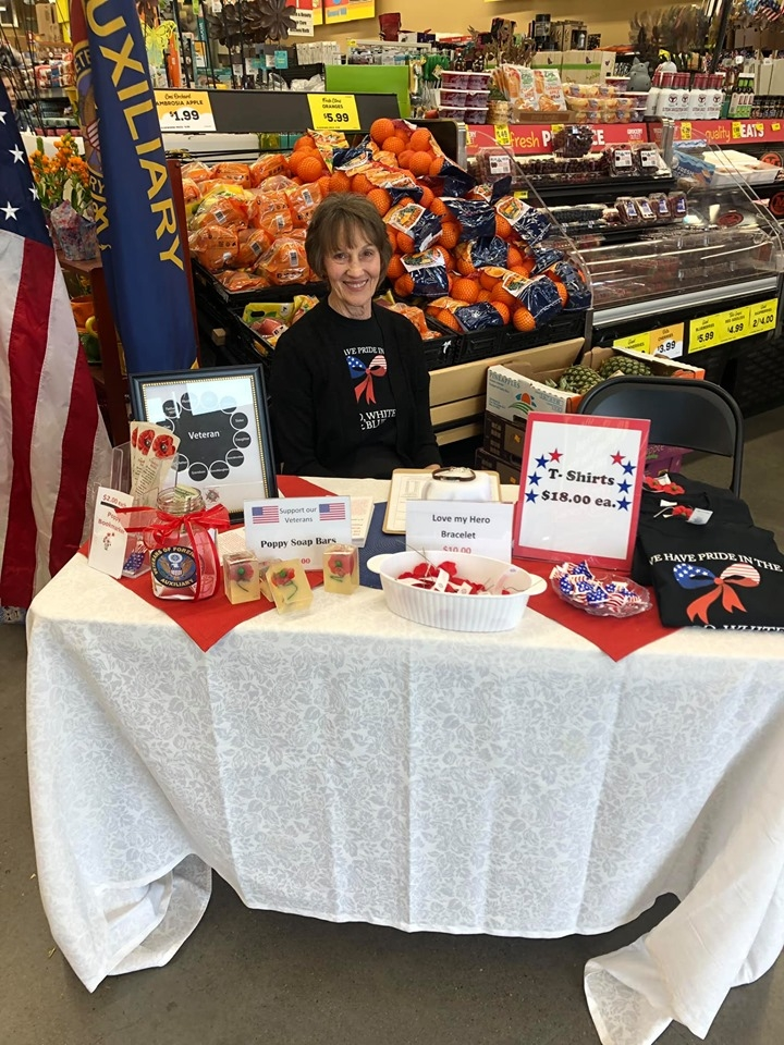President Jan McDonald at Zuxilliary booth for Memorial Day 2019 handing out Poppy flowers.